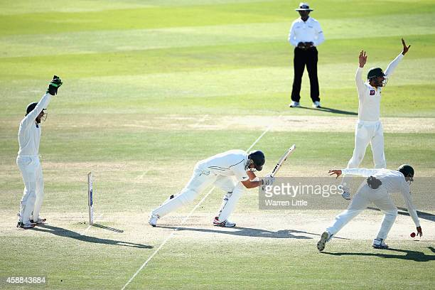 Ross Taylor of New Zealand is bowled lbw by Yasir Shah of Pakistan during day four of the first test between Pakistan and New Zealand at Sheikh Zayed...