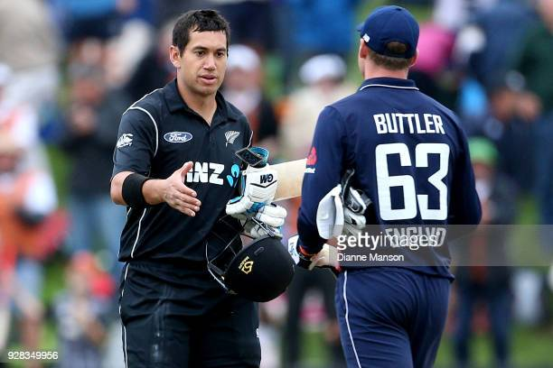Ross Taylor of New Zealand is congratulated by Josh Buttler of England after New Zealand win game four of the One Day International series between...