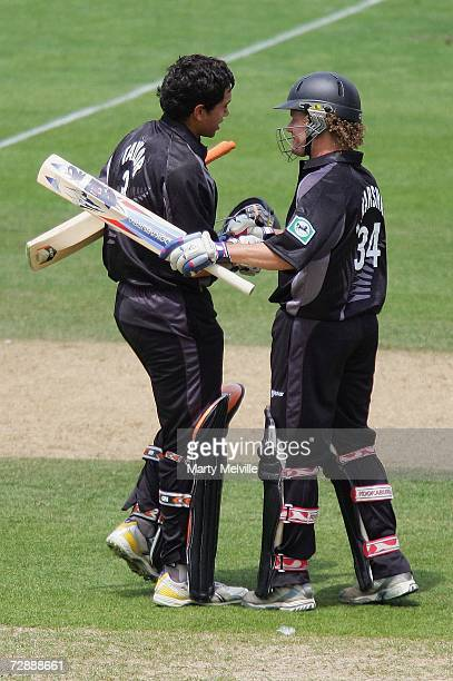 Ross Taylor of New Zealand is congratulated by team-mate Hamish Marshall after reaching his century during the 1st One Day International match...