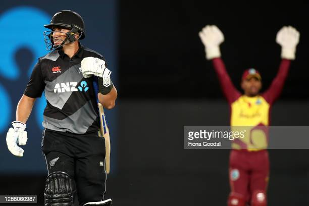 Ross Taylor of New Zealand is dismissed with Nicholas Pooran of the West Indies celebrating during game one of the International T20 series between...