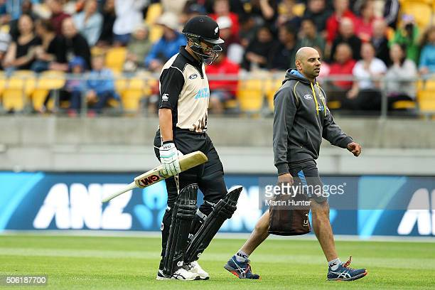 Ross Taylor of New Zealand is escorted off the pitch injured during during the Twenty20 International match between New Zealand and Pakistan at...