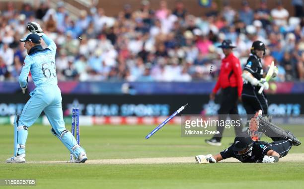 Ross Taylor of New Zealand is run out as Jos Buttler breaks the stumps after a throw from Adil Rashid during the Group Stage match of the ICC Cricket...