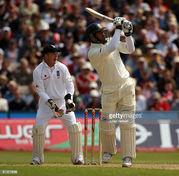 Ross Taylor of New Zealand is watched by Tim Ambrose as he hits out during the second day of the 2nd npower Test Match between England and New...