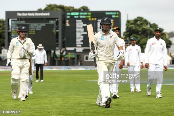 Ross Taylor of New Zealand leaves the field for lunch after scoring a century to surpass Martin Crowe's tally of centuries during day four of the...