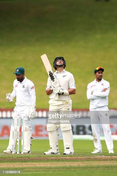 Ross Taylor of New Zealand looks to the sky after celebrating his century during day four of the second test match in the series between New Zealand...