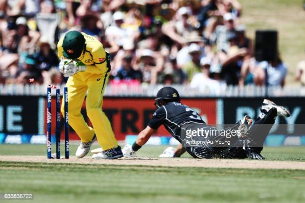 Ross Taylor of New Zealand makes it to the crease to avoid a run out by Peter Handscomb of Australia during game three of the One Day International...