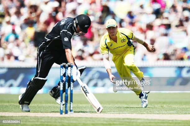 Ross Taylor of New Zealand makes it to the crease to avoid a run out by Marcus Stoinis of Australia during game three of the One Day International...