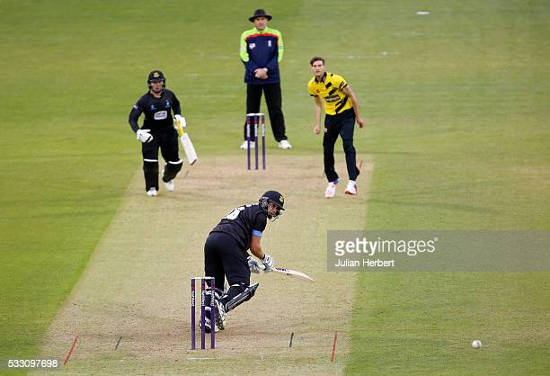 Ross Taylor of Sussex Sharks scores runs of the bowling of David Payne of Gloucestershire during the NatWest t20 Blast match between Gloucestershire...