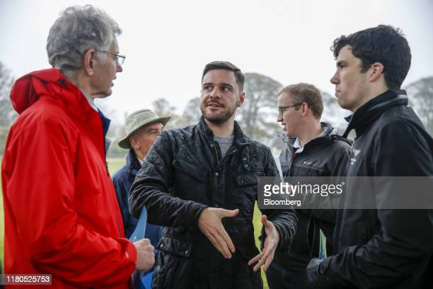 Ross Thomson, candidate for the Scottish Conservative Party in the Aberdeen South constituency, center, speaks with campaigners during the launch of...