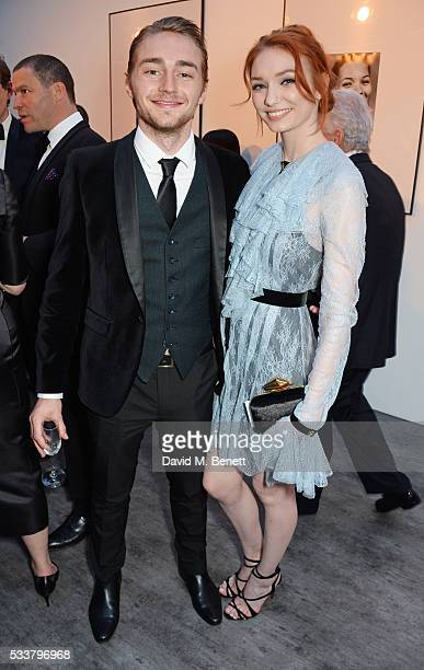 Ross Tomlinson and Eleanor Tomlinson attend British Vogue's Centenary gala dinner at Kensington Gardens on May 23 2016 in London England