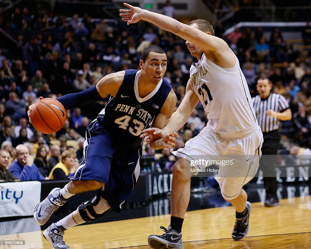 Ross Travis #43 of the Penn State Nittany Lions dribbles the ball against D.J. Byrd #21 of the Purdue Boilermakers at Mackey Arena on January 13, 2013 in West Lafayette, Indiana. Purdue defeated Penn State 60-42.