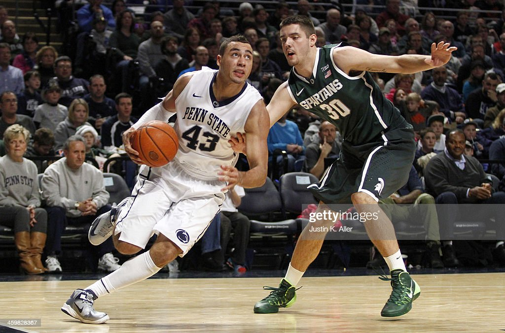 Ross Travis #43 of the Penn State Nittany Lions drives to the basket against the Michigan State Spartans at the Bryce Jordan Center on December 31, 2013 in State College, Pennsylvania.