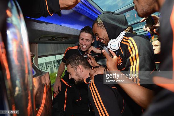 Ross Turnbull gets a haircut by Ashley Cole during the Chelsea victory parade following their UEFA Champions League and FA Cup victories on May 20...