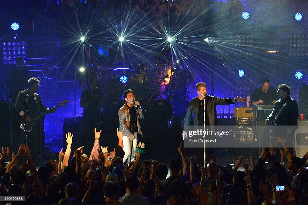 Ross Valory, Arnel Pineda, Gary LeVox and Neal Schon perform onstage as Journey and Rascal Flatts headline the Super Bowl XLVII CMT Crossroads Concert on February 2, 2013 in New Orleans, Louisiana.