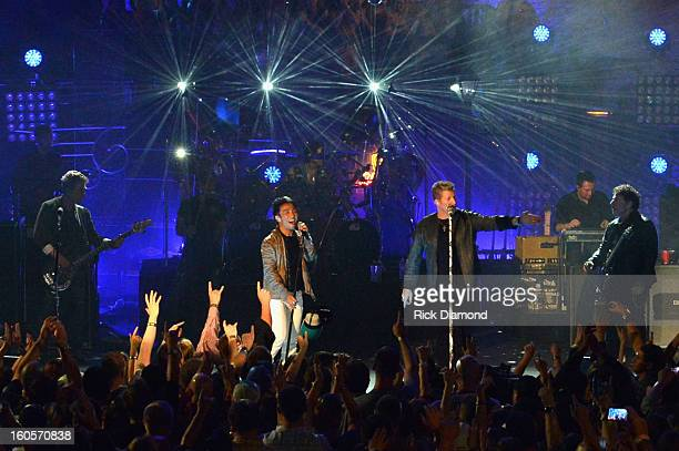 Ross Valory Arnel Pineda Gary LeVox and Neal Schon perform onstage as Journey and Rascal Flatts headline the Super Bowl XLVII CMT Crossroads Concert...