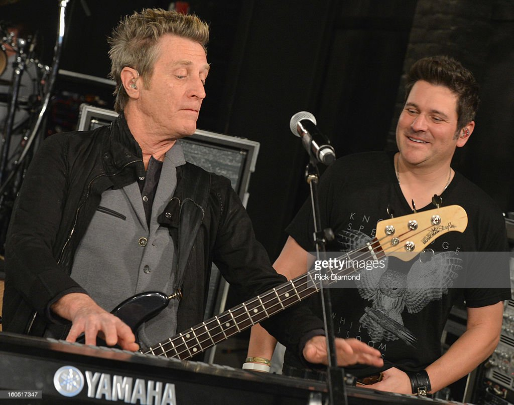 Ross Valory of Journey and Jay DeMarcus of Rascal Flatts perform during CMT Crossroads: Journey and Rascal Flatts Live from Super Bowl XLVII rehearsals on February 1, 2013 in New Orleans, Louisiana.