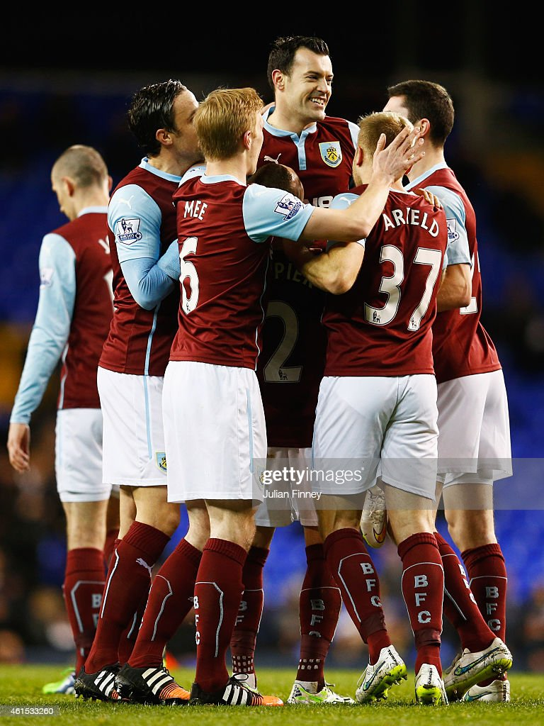 Ross Wallace of Burnley (C) celebrates with team mates as he scores their second goal during the FA Cup Third Round Replay match between Tottenham Hotspur and Burnley at White Hart Lane on January 14, 2015 in London, England.