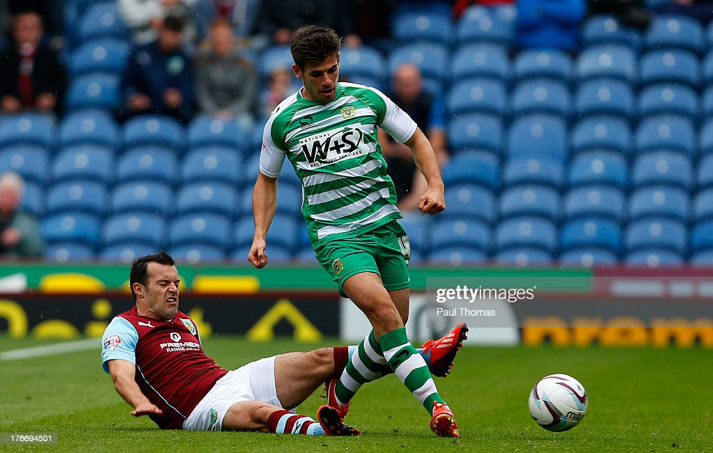 Ross Wallace of Burnley in action with Joe Edwards (R) of Yeovil during the Sky Bet Championship match between Burnley and Yeovil Town at Turf Moor on August 17, 2013 in Burnley, England