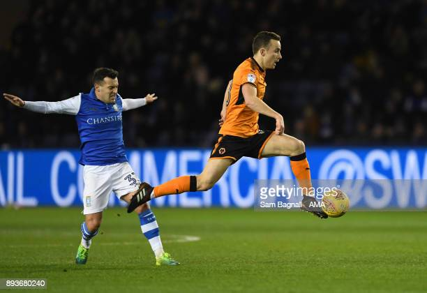 Ross Wallace of Sheffield Wednesday and Diogo Jota of Wolverhampton Wanderers during the Sky Bet Championship match between Sheffield Wednesday and...
