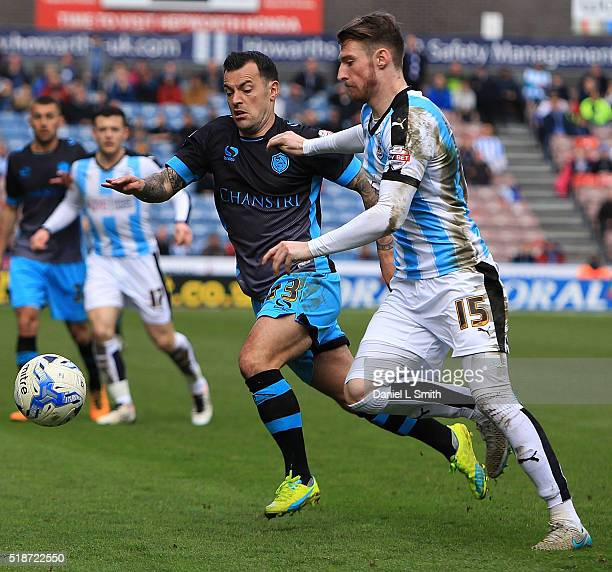 Ross Wallace of Sheffield Wednesday FC and James Husband of Huddersfield Town FC compete for the ball during the Sky Bet Championship match between...