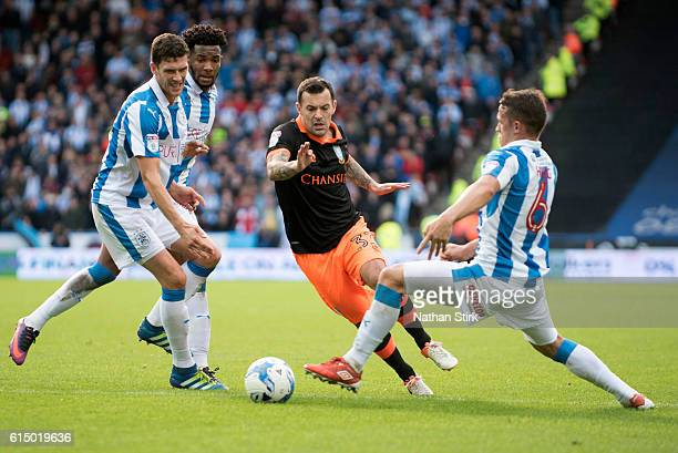Ross Wallace of Sheffield Wednesday is tackled by Jonathan Hogg of Huddersfield Town during the Sky Bet Championship match between Huddersfield Town...