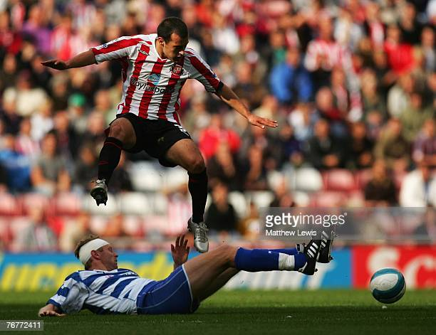 Ross Wallace of Sunderland beats the tackle from Bryn Gunnarsson of Reading during the Barclays Premier League match between Sunderland and Reading...