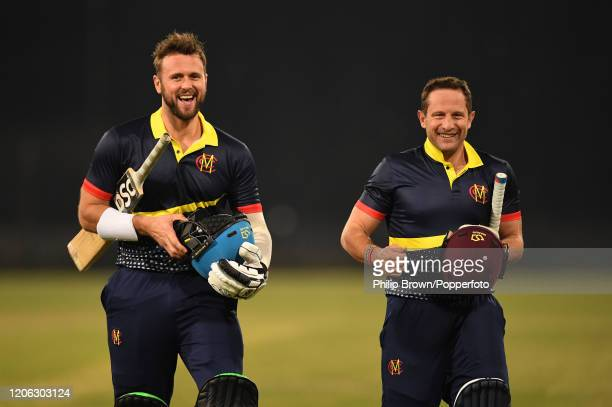 Ross Whiteley and Roelof van der Merwe of the MCC leave the field after winning the T20 match between an MCC team and Lahore Qalandars at Gaddafi...
