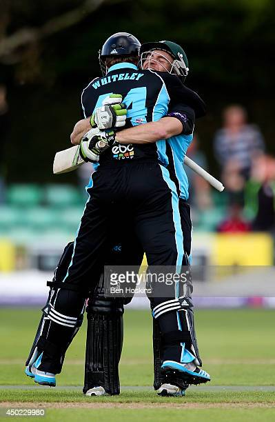 Ross Whiteley of Worcestershire celebrates with team mate Ben Cox after hitting the winning runs during the Natwest T20 Blast match between...