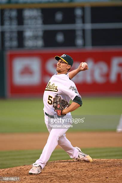 Ross Wolf of the Oakland Athletics pitches during the game against the Los Angeles Angels of Anaheim at the OaklandAlameda County Coliseum on July 10...
