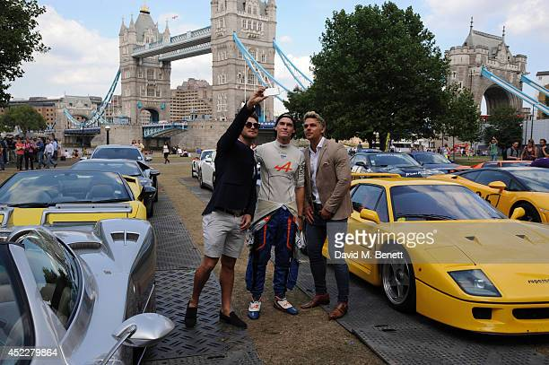 Ross Worswick Oliver Webb and Joss Mooney attend the 'Need For Speed' Supercar Convoy Tour photocall at Potters Field Park on July 17 2014 in London...