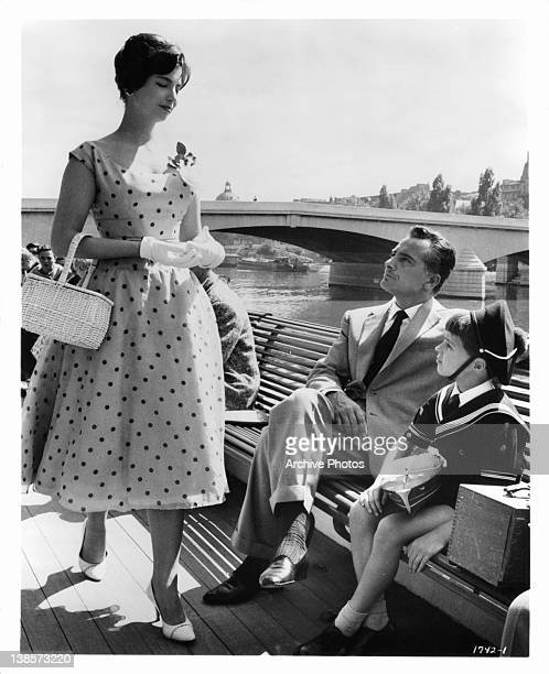 Rossano Brazzi instructs son Martin Stephens to always smile at pretty girls in a scene from the film 'Count Your Blessings' 1958