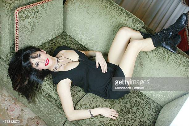 Rossella Brescia Italian tv character dancer and anchorwoman posing for a photo shoot lying on a sofa Italy 2008
