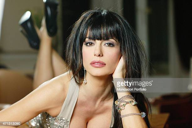 Rossella Brescia Italian tv character dancer and anchorwoman posing for a photo shoot lying on a small table Italy 2008