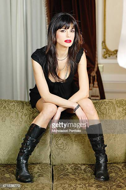 Rossella Brescia Italian tv character dancer and anchorwoman posing for a photo shoot seated on the back of a sofa Italy 2008