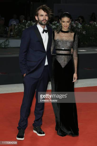 """Rossif Sutherland and Laysla De Oliveira walk the red carpet ahead of the """"Guest of Honour"""" screening during the 76th Venice Film Festival at Sala..."""