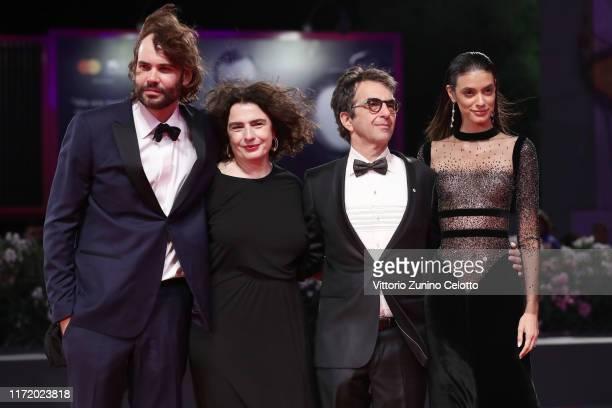 "Rossif Sutherland, Arsinee Khanjian director Atom Egoyan and Laysla De Oliveira walk the red carpet ahead of the ""Guest of Honour"" screening during..."