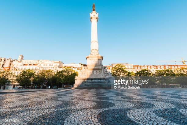 rossio square and the column of pedro iv, lisbon, portugal - ロッシオ広場 ストックフォトと画像