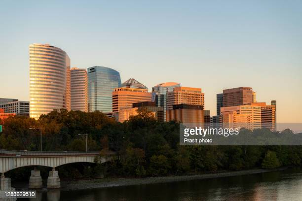 rosslyn skyline in early morning, washington dc, usa. a view n potomac river from georgetown park in us capital. - washington dc stock pictures, royalty-free photos & images