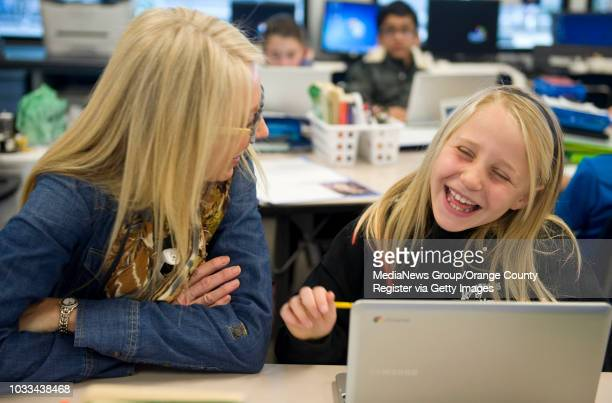 Rossmoor Elementary fourthgrade teacher Tami Sciacca shares a laugh with Addie Johnson during class The Los Alamitos school has posted eight years of...