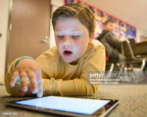 Rossmoor Elementary kindergartner Lucas Irons uses an iPad to do math The school has 350 iPads for 700 students shot 020414 rankingsele0216 Rossmoor...