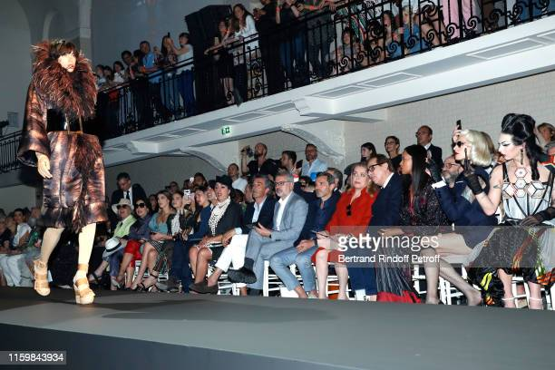 Rossy de Palma CoOwner of Gaultier Marc Puig Catherine Deneuve Gilles Dufour and Miss Fame attend the Jean Paul Gaultier Haute Couture Fall/Winter...