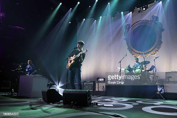 Rostam Batmanglij Ezra Koenig and Chris Tomson of Vampire Weekend perform on stage on Day 15 of iTunes Festival 2013 at The Roundhouse on September...