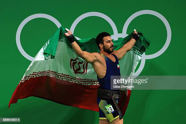 Rostami Kianoushof Iran sets a new world record and celebrates winning the gold medal during the Weightlifting Men's 85kg on Day 7 of the Rio 2016...