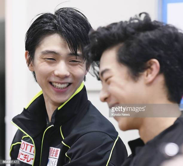 Rostelecom Cup runnerup Yuzuru Hanyu of Japan and winner Nathan Chen of the United States chat during a press conference in Moscow on Oct 21 after...