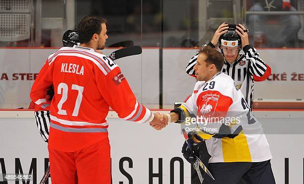 Rostislav Klesla of Ocelari Trinec and Chris Abbot of HV71 Jonkeping shake hands before the Champions Hockey League round of thirtytwo game between...