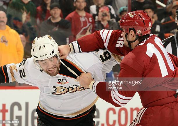 Rostislav Klesla of the Phoenix Coyotes lands a punch against Patrick Maroon of the Anaheim Ducks at Jobingcom Arena on January 11 2014 in Glendale...