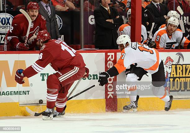 Rostislav Klesla of the Phoenix Coyotes pokes the puck away from Wayne Simmonds of the Philadelphia Flyers at Jobingcom Arena on January 4 2014 in...