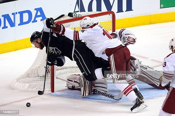 Rostislav Klesla of the Phoenix Coyotes throws the check against Jeff Carter of the Los Angeles Kings in Game Four of the Western Conference Finals...