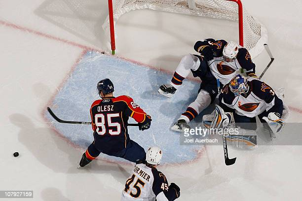 Rostislav Olesz of the Florida Panthers misses the rebound as the Atlanta Thrashers net is knocked off its mooring on January 5 2011 at the...