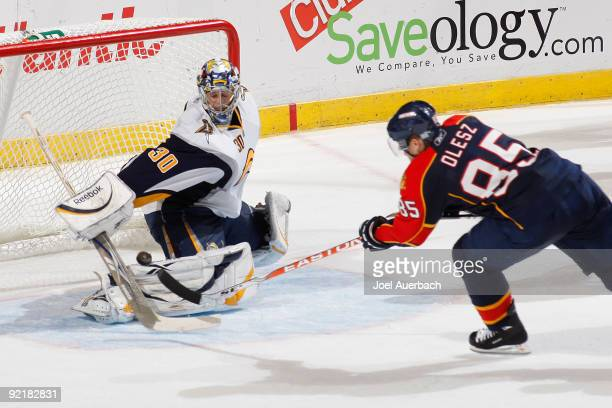Rostislav Olesz of the Florida Panthers scores a goal past goaltender Ryan Miller of the Buffalo Sabres in the third period on October 21 2009 at the...